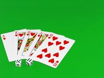 Royal flesh- playing cards on green broadcloth. Royalty Free Stock Images