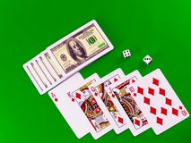 Royal flesh- playing cards on green broadcloth. Stock Images