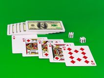 Royal flesh- playing cards on green broadcloth. Royalty Free Stock Photos