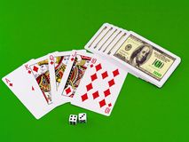 Royal flesh- playing cards on green broadcloth. Stock Photos