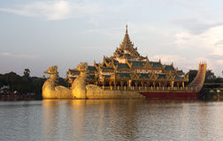 The Royal Floating Barge at sunset, Karaweik Lake Yangon, Burma Royalty Free Stock Photography