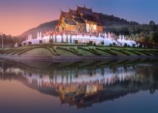 Royal Flora Ratchaphruek Park at sunset Chiang Mai. Royal Flora Ratchaphruek Park and pavilion during violet sunset Chiang Mai with reflection on water, Thailand stock photos