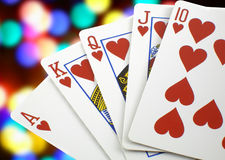 Royal flush. Highest poker hand over multicoloured background royalty free stock photography