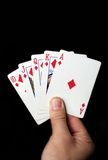 Royal flush. Hand holding royal flush close up Royalty Free Stock Photo