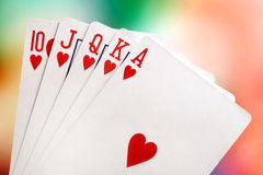 Royal flush. With brightly-coloured background Royalty Free Stock Photos