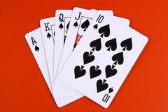 Royal Flush. In spades with red background Royalty Free Stock Image