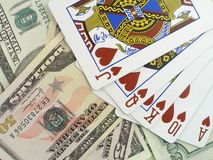 Royal flush. Highest poker hand, over US dollars background royalty free stock image