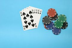 Royal Flush. With chips on the table Royalty Free Stock Photos