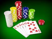 Royal flush. Gambling chips and poker cards on green carpet - 3D render Royalty Free Stock Photos