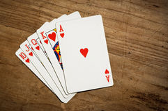 Royal flush. Of hearts poker hand spread on old wooden table with copy space Stock Photo