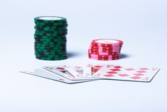Royal flush. Piles of counters and Royal flush on a white background Stock Images