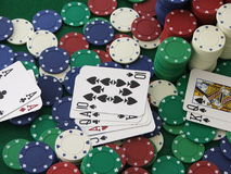 Royal Flush. A classic hand of Texas Hold'em Poker: one player gets four aces, and the other gets a Royal Flush royalty free stock photography