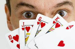Royal flush. Gambler with royal flush in hand Stock Images