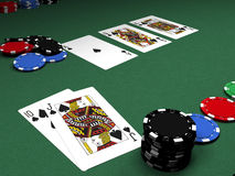 Royal Flush. Closeup of playing cards and betting chips on green felt table in a poker game.  Cards show a royal flush in spades Stock Photography
