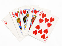 Royal flush. Hearts royal flush isolated over white background Royalty Free Stock Images