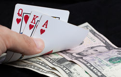Royal Flush and bank note on black background Stock Image