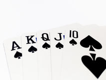 Royal Flush Card in Poker Game with White Background. A playing card is a piece of specially prepared heavy paper, thin cardboard, plastic-coated paper, cotton Royalty Free Stock Image