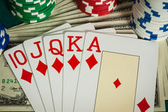 Royal flush cards, dollar bills and casino chips Stock Image