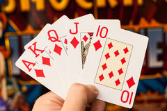 Royal flush cards holding in hands Royalty Free Stock Images