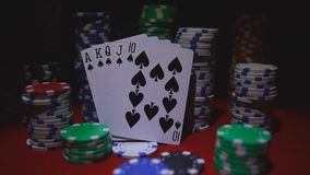 Royal flush on cards and poker chips stock video footage
