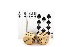 Royal Flush of Cards in Spades with Wooden Dice Stock Photo