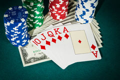 Royal flush casino cards with dollar and chips Stock Photos