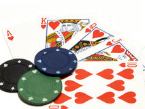 Royal flush and casino chips. Isolated over white Royalty Free Stock Images