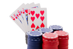 Royal Flush and chips. Royal flush poker hand behind stack of poker chips isolated on white background stock photography
