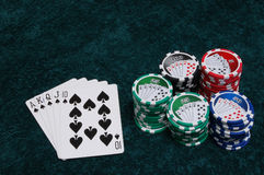 Royal Flush and Chips. A royal flush and a pile of chips Royalty Free Stock Image
