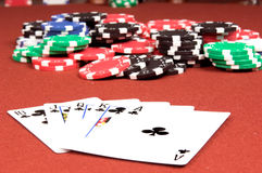 Royal Flush Clubs. One of the highest hands in poker a Clubs Royal Flush on a red felt gaming table with a no limit jackpot in the background Stock Photo