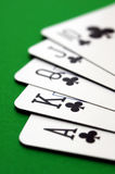Royal flush of clubs. Poker cards, clubs royal flush closeup on green table Stock Photography