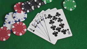 Royal Flush of Clubs and Poker Chips Royalty Free Stock Photos