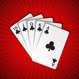 A royal flush of clubs on red background, winning hands of poker Stock Photo