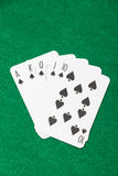 Royal flush combination at poker on the green table Royalty Free Stock Images