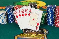 Royal flush of diamond casino cards and chips Royalty Free Stock Images