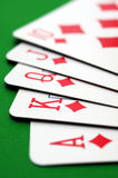 Royal flush of diamonds. Poker cards, diamonds royal flush closeup on green table Royalty Free Stock Photo