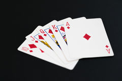 Royal Flush of diamonds in poker cards game on a black background Stock Images