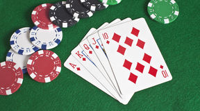 Royal Flush of Diamonds and Poker Chips Stock Images