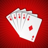 A royal flush of diamonds on red background, winning hands Royalty Free Stock Photography