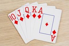 Royal flush diamonds - casino playing poker cards. Royal flush diamonds - winning hand of gambling casino poker playing cards on a table royalty free stock image
