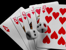 Royal flush with dice. Rolling on top Royalty Free Stock Images
