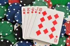 A royal flush displayed with poker chips. A royal flush displayed with a full frame of poker chips Royalty Free Stock Photo