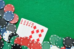 A royal flush displayed with poker chips. On a green background Royalty Free Stock Photography