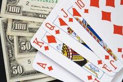 Royal flush earning. Make a lot of money plaiyng card Royalty Free Stock Photo
