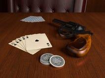 Royal Flush and gun Stock Image