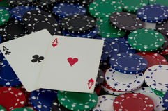 Royal Flush of Hearts. Pocket aces Texas Hold'em Poker hand sitting on top of a pile of casino chips Royalty Free Stock Image