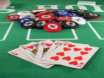 Royal Flush Hearts. Royal flush of hearts in a poker hand on a green felt table top Royalty Free Stock Images