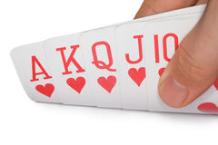 Royal flush of hearts, cards in human hand Stock Photo