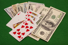 Royal Flush Hearts And Dollar Money On Green Felt Royalty Free Stock Photo