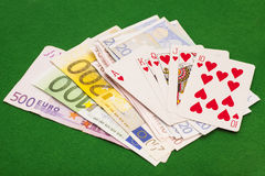Royal flush hearts and euro money Stock Photo